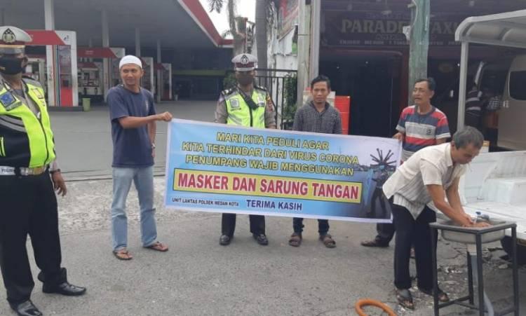 Polsek Medan Kota Wajibkan Penumpang dan Sopir Angkutan Umum Gunakan Masker serta Sarung Tangan