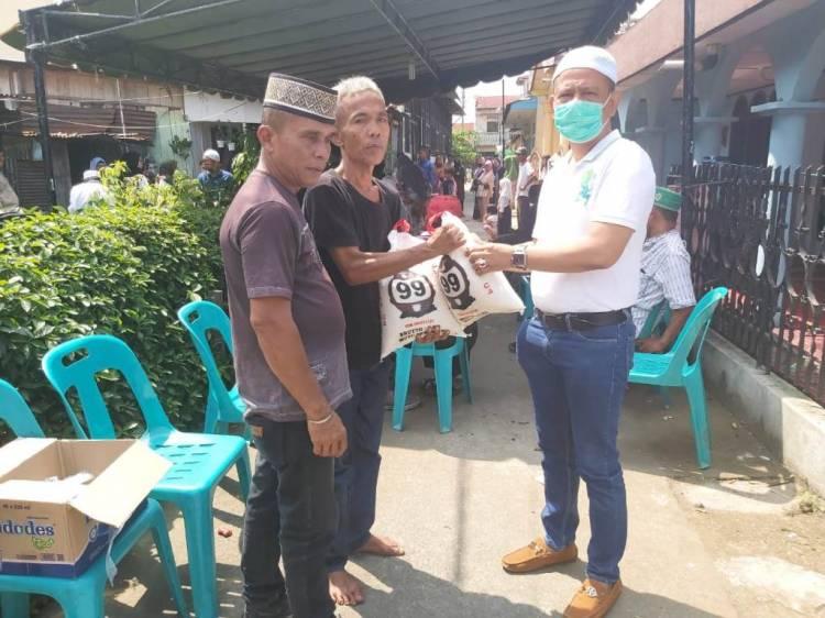 Ketua Pewarta Melayat di Rumah Almarhum Rizal Efendi Siregar dan Berikan Santunan