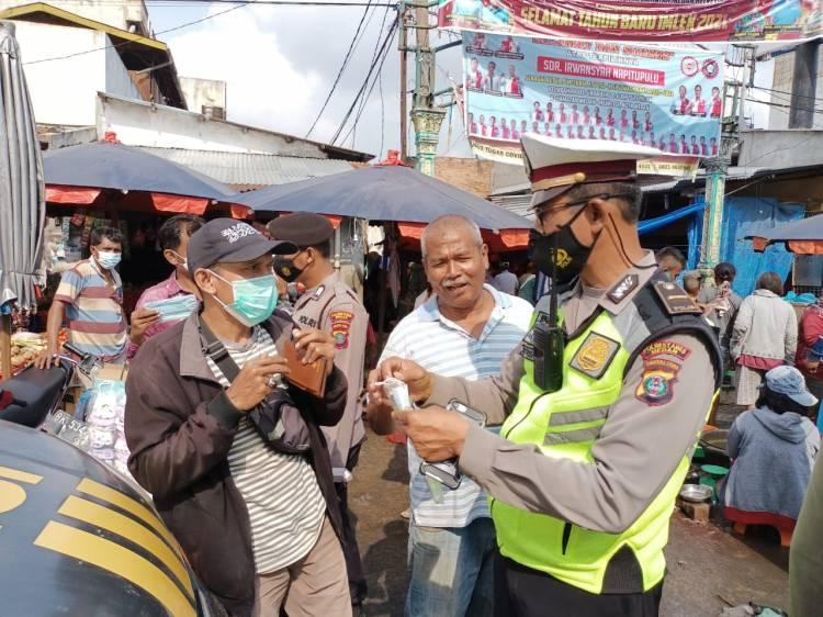 Lawan Corona, Polsek Medan Helvetia Ajak Warga Taati  Protokol Kesehatan