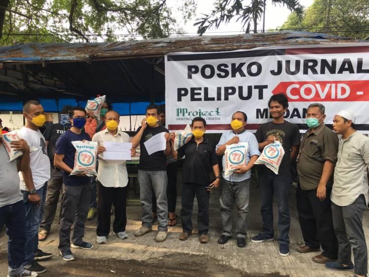 Lawan Covid-19, Komjen Agus Andrianto dan Kombes Tatan Salurkan Bantuan kepada Jurnalis Medan