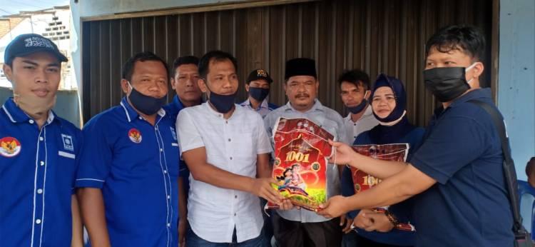 Ketua Fraksi PAN DPRD Deli Serdang Salurkan 300 Karung Beras