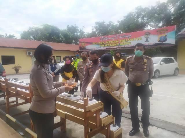 Dukung Program Ketahanan Pangan, di Polsek Medan Helvetia Miss Grand Sumut 2019 Tanam Kangkung