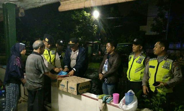Polsek Medan Baru Bantu Korban Banjir di Padang Bulan