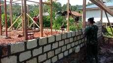 Satgas TMMD 108 Kodim 1709/Yawa Bangun 13 Rumah Permanen