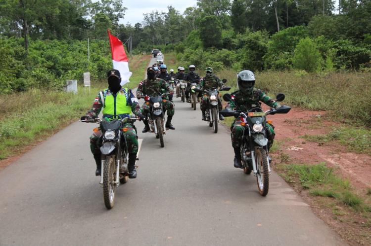 Satgas Pamtas RI PNG Yonif Mekanis Raider 411 Kostrad Gelar Touring Kemerdekaan