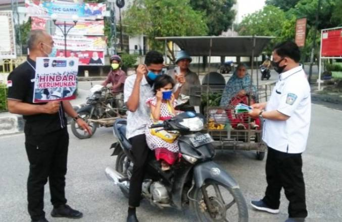 Operasi Yustisi, Satres Narkoba Polres Tanjungbalai Bagikan 350 Masker Gratis
