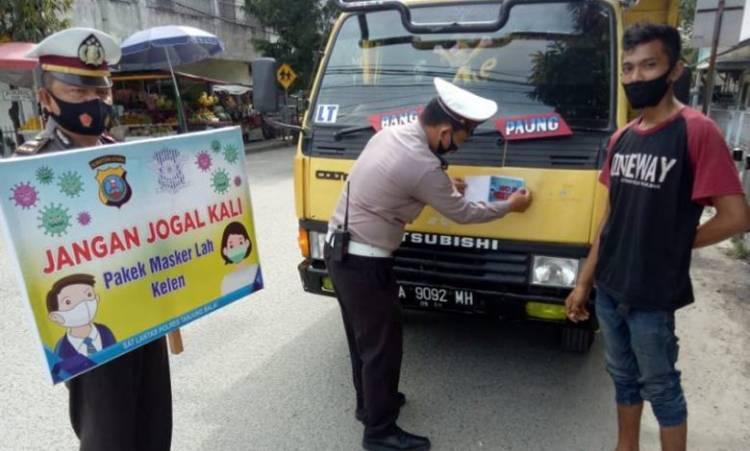 Polres Tanjungbalai Razia Masker Keliling, Ingatkan Masyarakat Patuhi Prokes: Jangan Jogal Kali