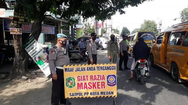 Polsek Percut Razia Masker di Jalan Letda Sujono Medan, Belasan Warga Terima Sanksi