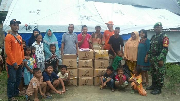 Prajurit TNI Kogasgabpad Bantu Distribusikan Logistik Pengungsi di Palu