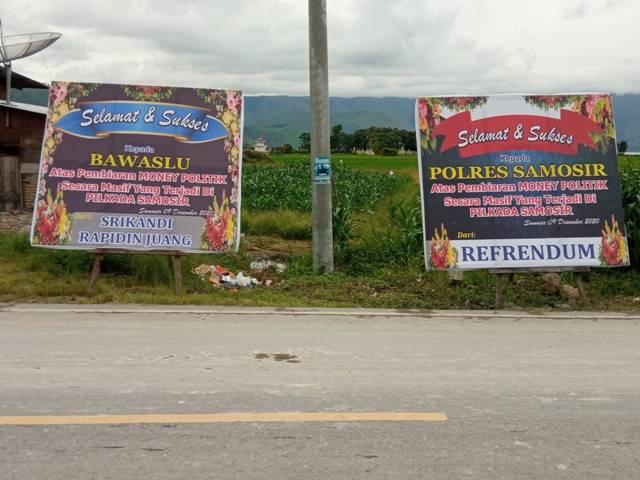Papan Bunga dan Spanduk Terkait Politik Uang Ramaikan Kota Pangururan Samosir